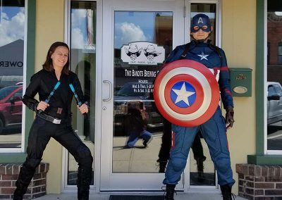 Superheroes in front of brewery
