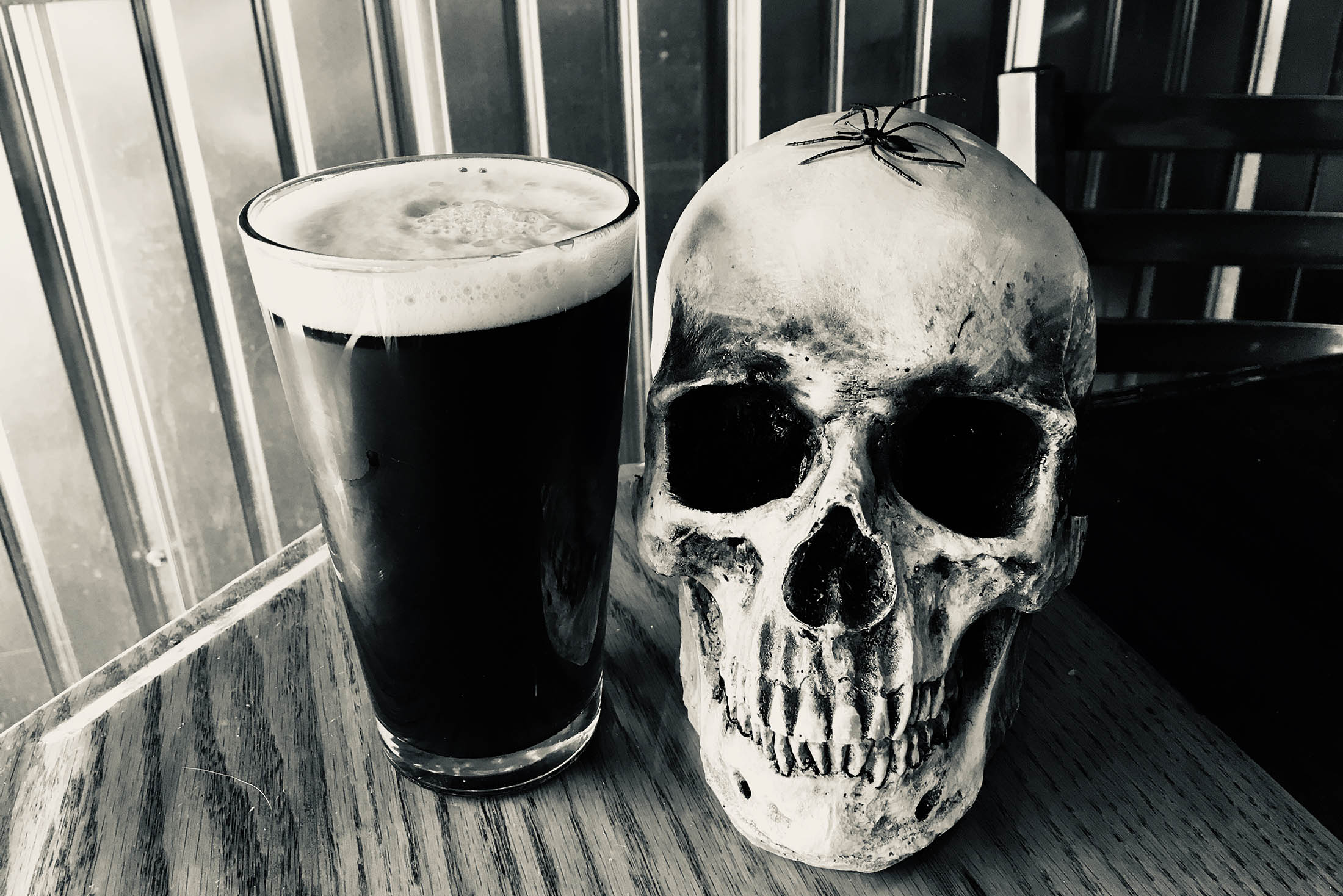 Pint of beer with a skull